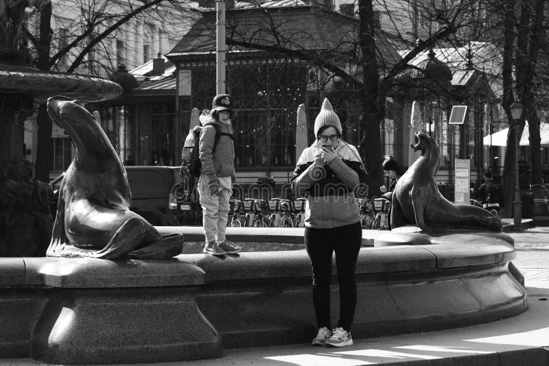 Helsinki/Finland - April 07 2019: People on street of an European city stock photography