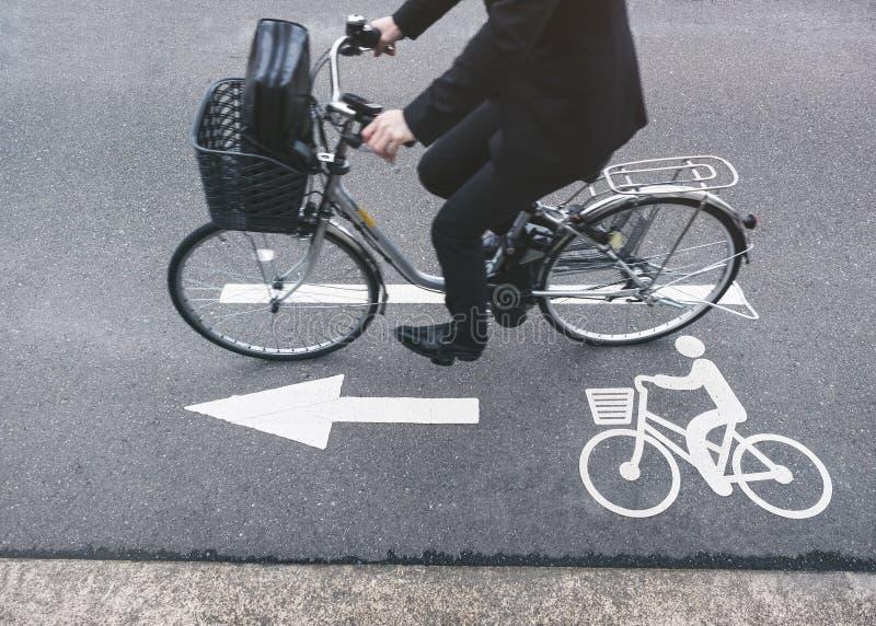 People ride bicycle on Road Bike lane Signage. People ride bicycle on Road with bike lane sign City transportation stock photo