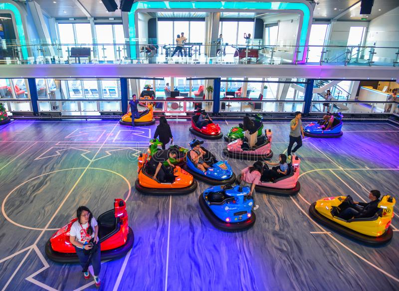 People ride in bumper car at amusement park. Shanghai, China - Jun 3, 2019. A group of happy people joy ride in bumper car on fairground rides at amusement park stock photography