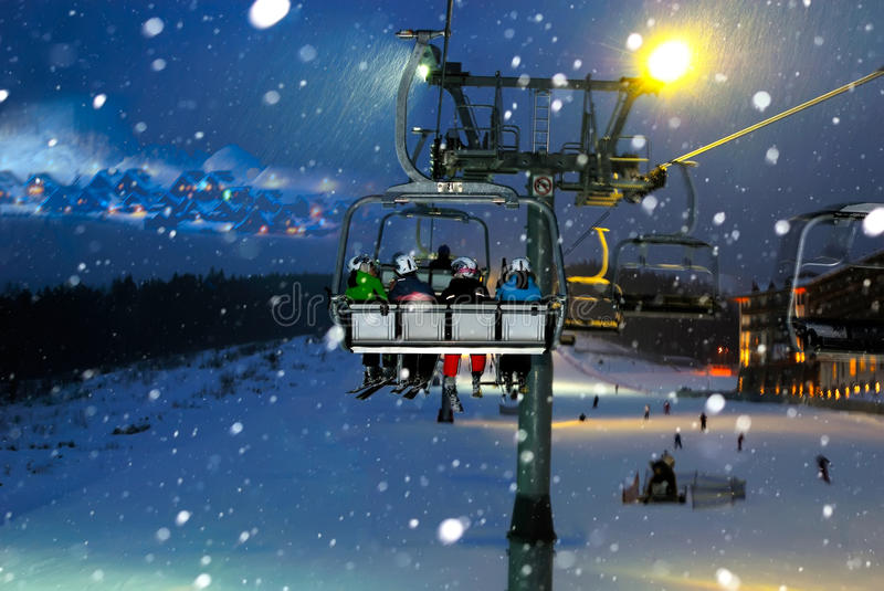 Download People Ride In The Chairlift At Night Stock Photo - Image of cable, people: 23611840