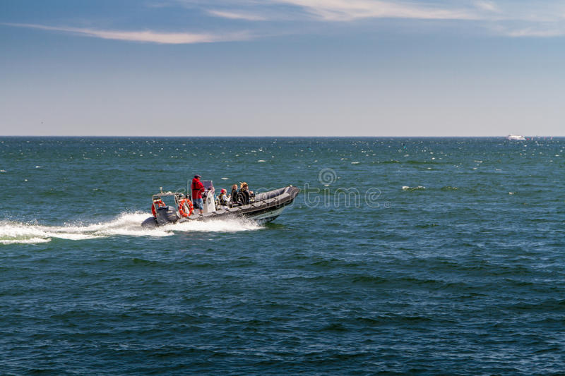 People ride on a motor boat stock images
