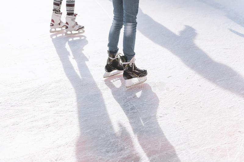People ride on the skating rink on the ice rink during the Christmas holidays. Sports and fun pastime stock photo