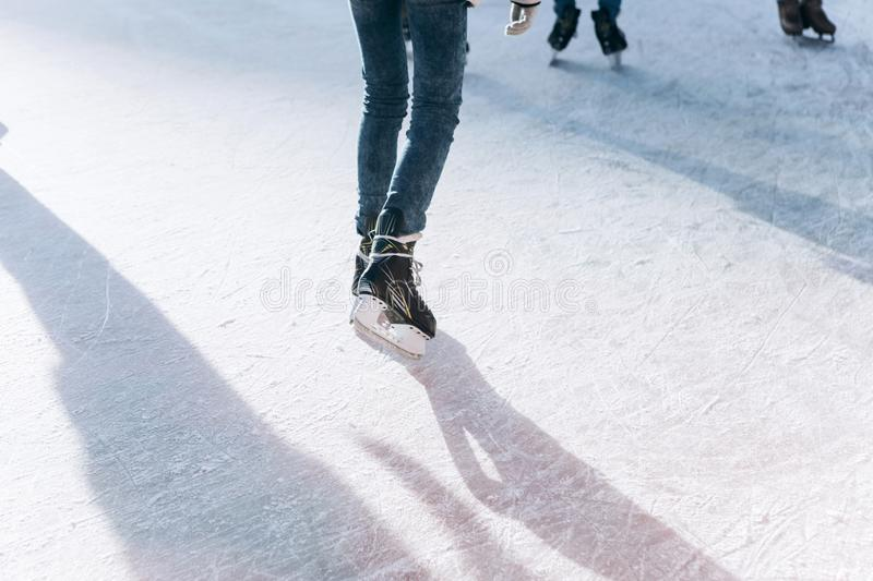 People ride on the skating rink on the ice rink during the Christmas holidays. Sports and fun pastime royalty free stock image
