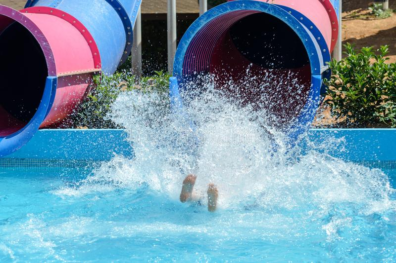 People ride water slides in the water park. Image of people ride water slides in the water park royalty free stock image