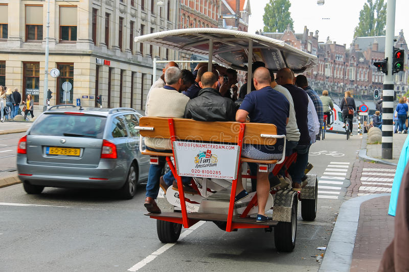 People riding beer bicycle in Amsterdam, the Netherlands stock photos