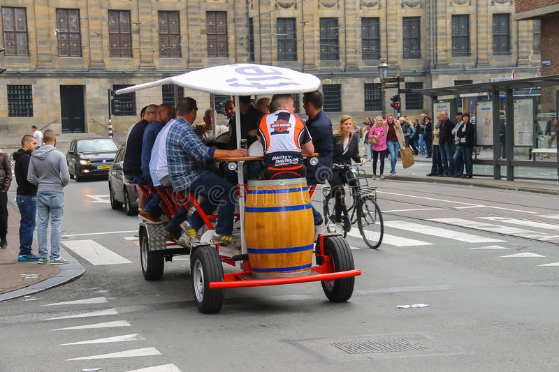 People riding beer bicycle in Amsterdam, the Netherlands royalty free stock photo