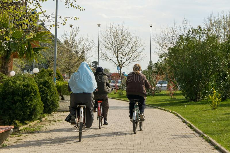 People riding bicycle in Shkoder city stock photo