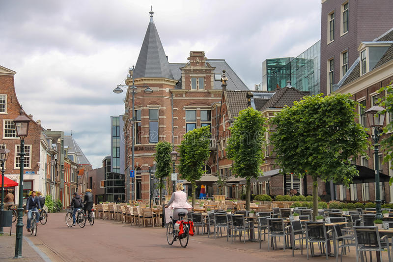 People riding a bike in the historic center of Haarlem stock image
