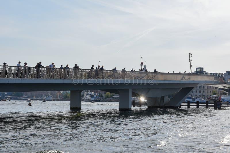 People riding bikes on the bridge in the center of Copenhagen, Denmark stock photography