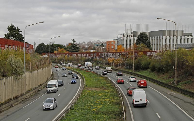 People are riding in cars on the road in Toulouse, France stock photos