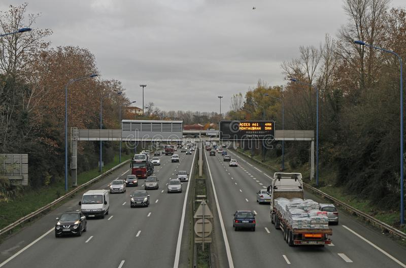 People are riding in cars on the road in Toulouse, France stock image