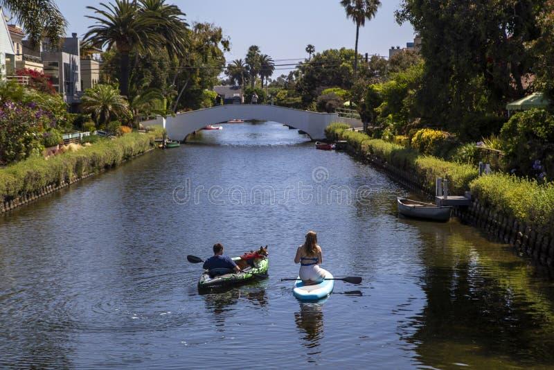 People on kayak in Venice California. People riding kayaks in Venice neighborhood canals in California stock photography
