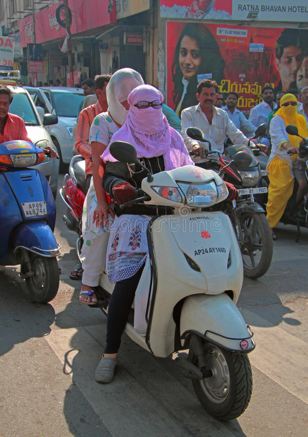 People are riding on motorcycle in Hyderabad, India. Hyderabad, India - March 11, 2015: people are riding on motorcycle in Hyderabad, India stock photos