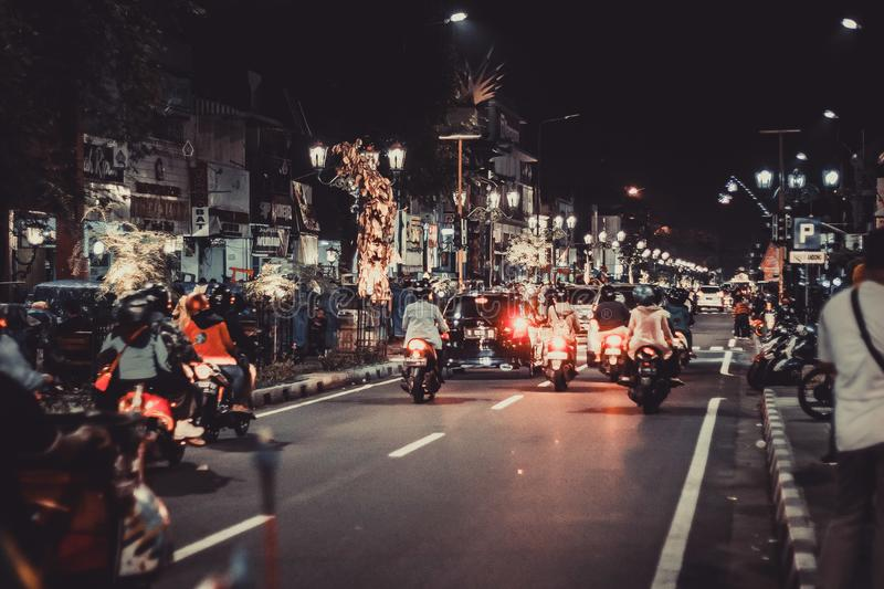 People Riding Motorcycles On Road During Night Time stock photography