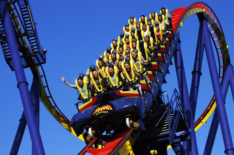 People riding roller coaster royalty free stock photography