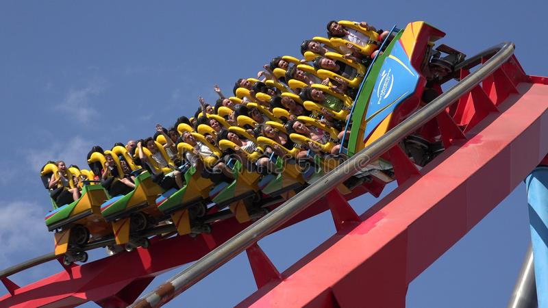 People Riding On Roller Coaster stock photo