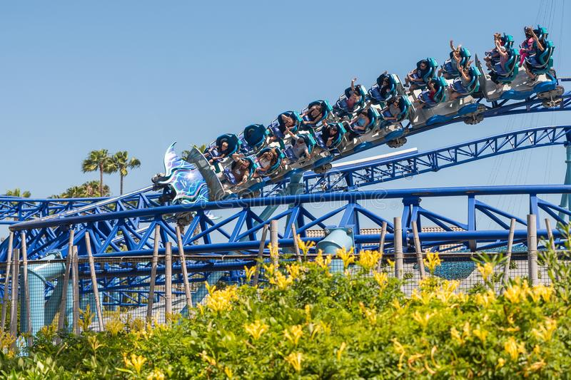 Manta Ray Roller Coaster Ride at Seaworld San Diego southern california USA. People riding the roller coaster at the sea world san Diego. The ride is very stock photo