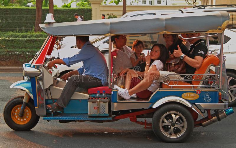 People are riding in tuk-tuk royalty free stock images
