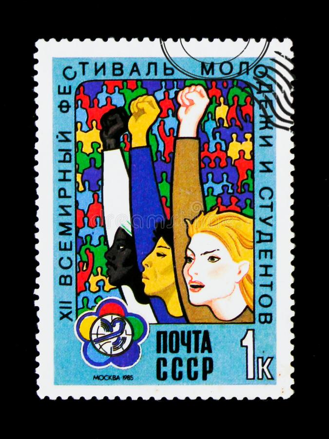 People rise hands, dedicated to the 12th Festival of Youth and Students in Moscow, circa 1985. MOSCOW, RUSSIA - JUNE 26, 2017: A stamp printed in USSR Russia stock images