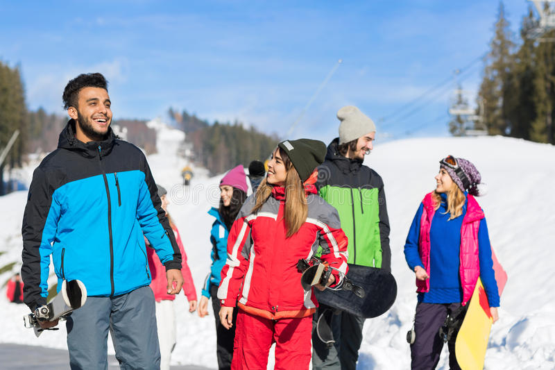 People roup With Snowboard And Ski Resort Snow Winter Mountain Friends Communication stock photo