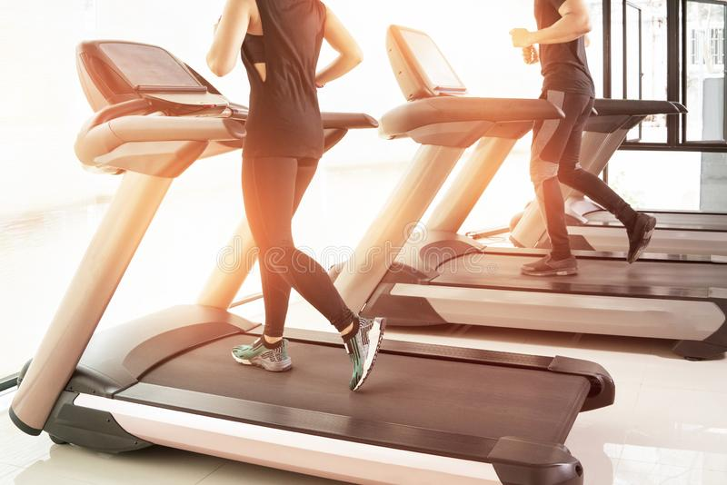 People running in machine treadmill at fitness gym club, royalty free stock photo