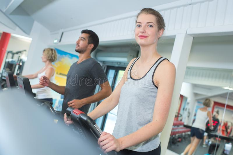 People running in machine treadmill at fitness gym royalty free stock photos