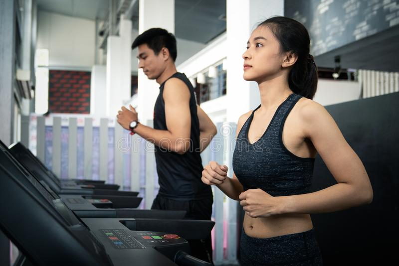 People running in machine treadmill at fitness gym royalty free stock photography