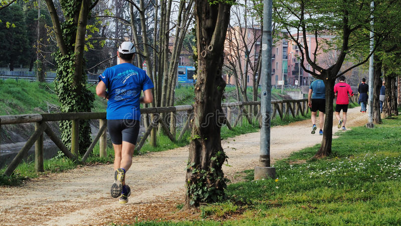 People running at a springtime afternoon. stock images