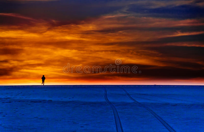 People running to the top of dune stock photos