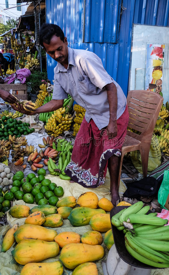 People at a rural market in Colombo, Sri Lanka. Colombo, Sri Lanka - Sep 5, 2015. A vendor at local market in Colombo, Sri Lanka. Colombo is the commercial stock image