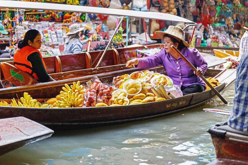 Ratchaburi / Thailand - April 21 2018:People sale fruit as banana in the boat at floating market. royalty free stock photography