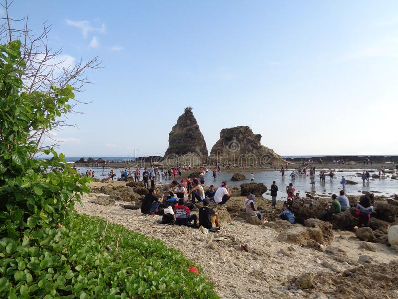 People at Sawarna beach, coral beach at Banten, Indonesia 2015 stock images