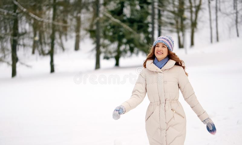 Happy smiling woman outdoors in winter forest stock photos