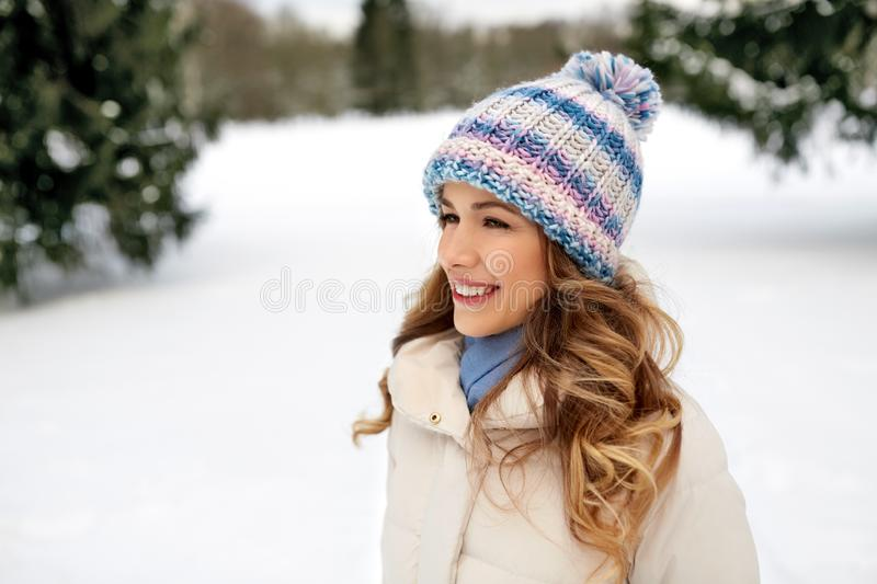 Portrait of happy smiling woman outdoors in winter royalty free stock photo