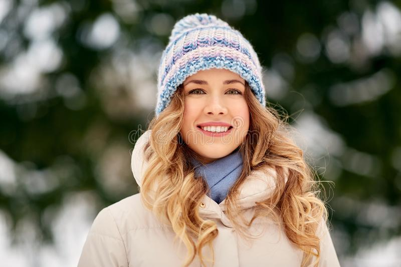 Portrait of happy smiling woman outdoors in winter royalty free stock image