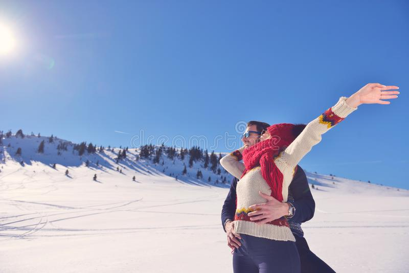 People, season, love and leisure concept - happy couple hugging and laughing outdoors in winter royalty free stock photography