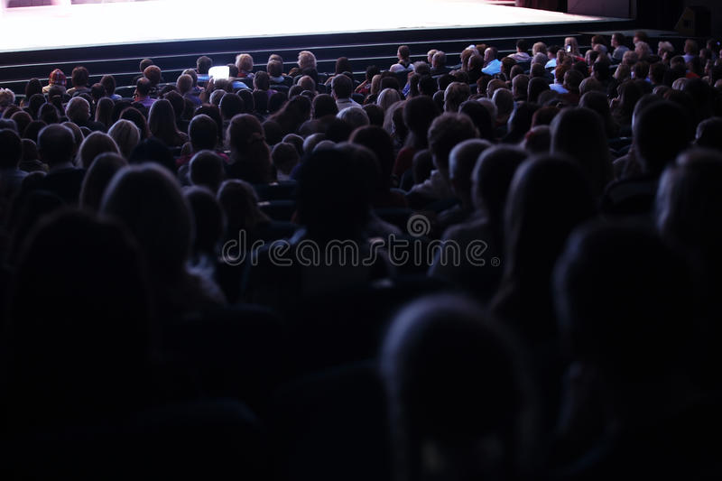 People seated in an audience stock photography