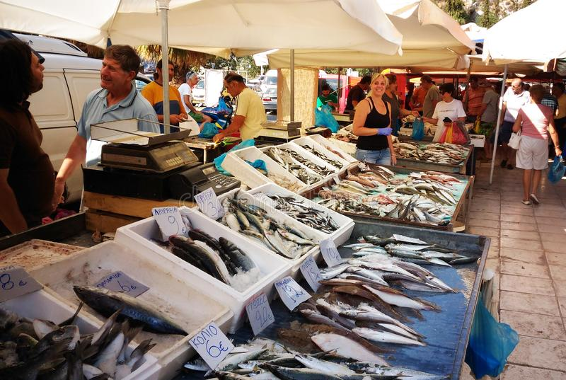 People sell and buy fish in market Loutraki, Greece 07.02.2017: stock photo