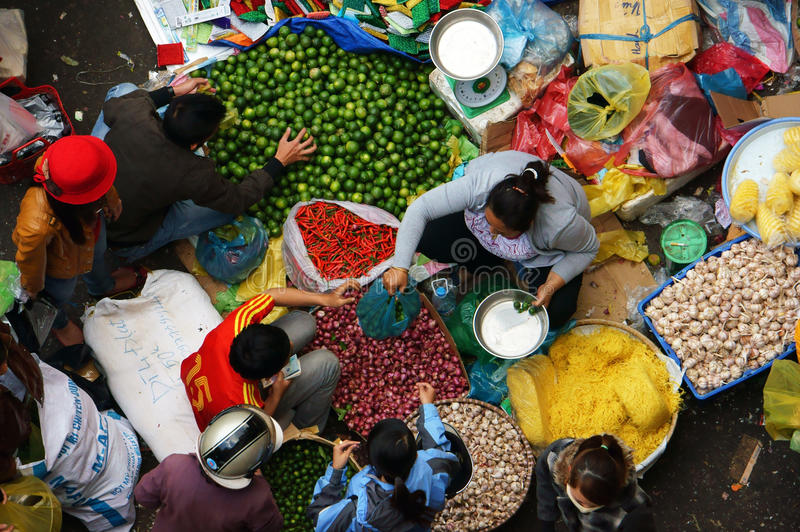 People sell and buy spice at open air market. DA LAT, VIET NAM- FEBRUARY 8, 2013 stock image