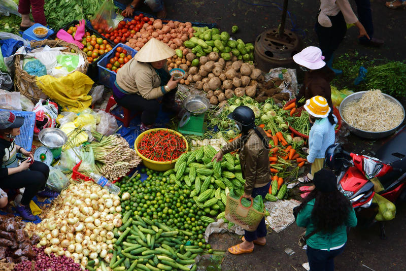 People sell and buy vegetables at open air market. DA LAT, VIET NAM- FEBRUARY 8, 2013 royalty free stock photo
