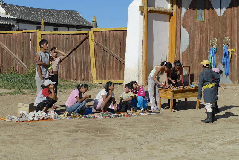 People sell souvenirs at the entrance to the Erdene Zuu monasteryin Kharkhorin, Mongolia. royalty free stock photo