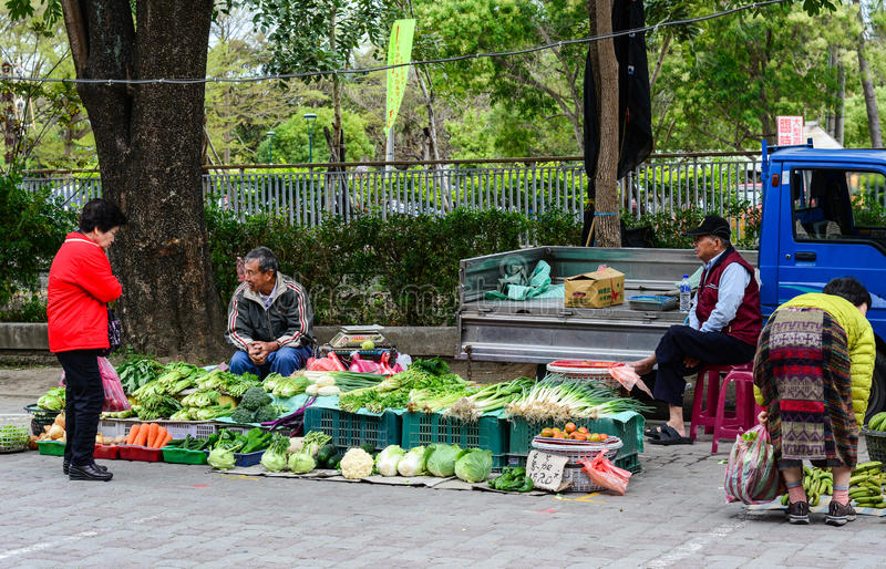 People sell vegetables on street in Taichung, Taiwan stock photo