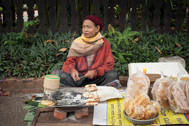 People selling food at traditional asian marketplace. Laos royalty free stock image