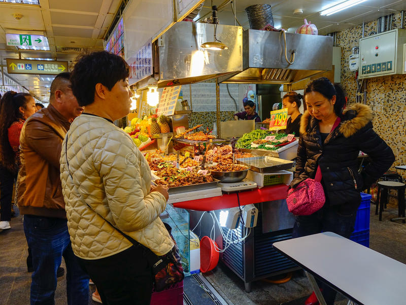 People selling foods at market in Taipei, Taiwan. People selling foods at night market in Taipei, Taiwan stock photos