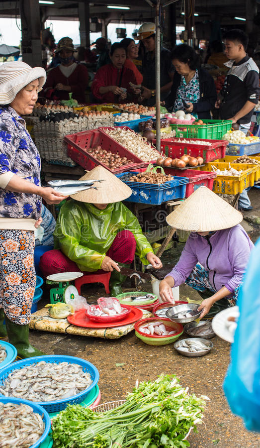 People selling goods at market in Hoi An, Vietnam royalty free stock photo