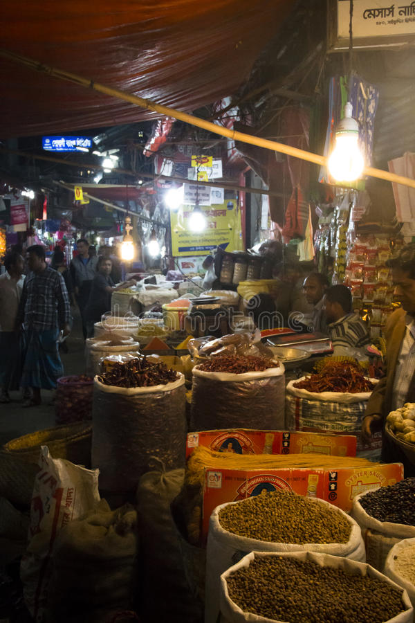 People selling spices in Chittagong, Bangladesh. CHITTAGONG, BANGLADESH - FEBRUARY 2017: People with a small shop selling spices in the central bazar market in royalty free stock images