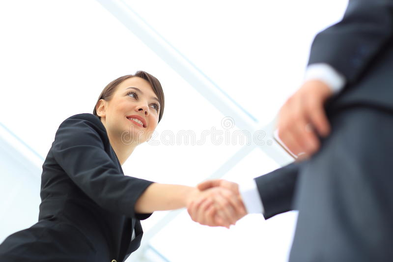 People shaking hands stock images