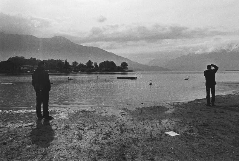 People shooting on Lake of Como, Film frame, black and white analog camera stock photography
