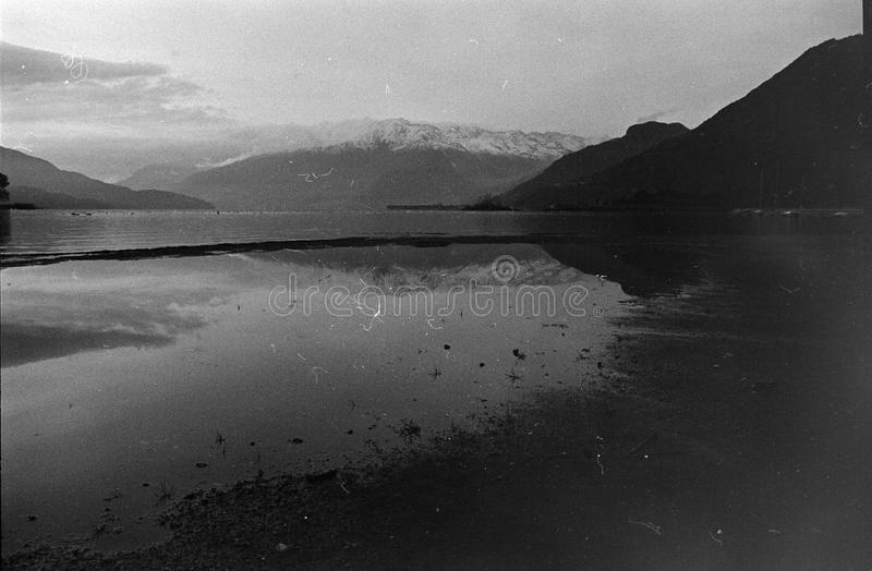 People shooting on Lake of Como, Film frame, black and white analog camera royalty free stock photography