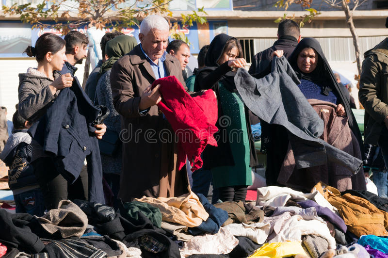 People shopping for clothes in Iraq. People shopping for winter clothes in a flea market in Iraq royalty free stock photography